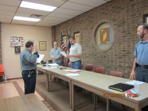 Sec-Treas. Brian Wear giving President Freddie Hubbard Sr. the Oath of Office
