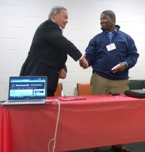 Executive Vice-President Steve Shively congratulating Russel on his newly appointed position.